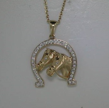 Horseshoe pendant in 14kt yellow gold with double horse head.  35 diamonds =.20ct  style 842-0016  $1600.00