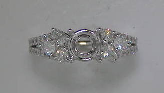 18kt white gold ring with 4 pear shape diamonds =.36ct and 30 diamonds = .34ct  style 223-0138  $3700.00