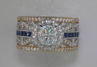 semi engagement ring in 14kt yellow and white gold =.68ct in sapphire and 1.13ct in diamonds  style 405-0185  $4775.00