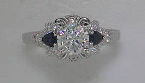 semi engagement ring in 14kt white gold =.38ct in sapphire and .23ct in diamonds   style 405-0193   $1850.00