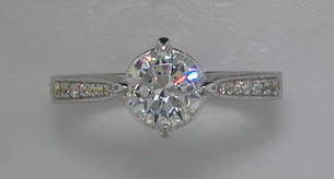 semi engagement ring in 14kt white gold =.23ct style 405-0215  $1600.00