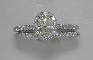 .50ct oval in 14kt white gold with 53 diamonds =.50ct  style 33276WE-W  $4100.00