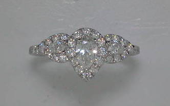.36ct pear shaped center in 14kt white gold with 2 pear shaped side stones =.14ct and 42 round diamonds =.50ct  style 34241ENG-W  $3950.00