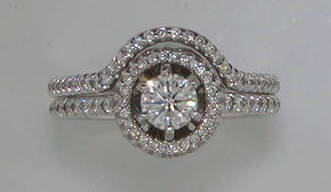 .46ct bridal set.  Halo design.  14kt white gold with 176 diamonds =.85ct  style ENS3183-A-B  $5100.00