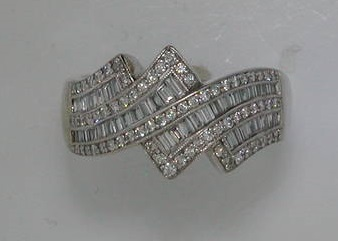 18kt white gold with 51 round diamonds =.20ct and 43 baguettes =.47ct  style 500-2195  $5000.00