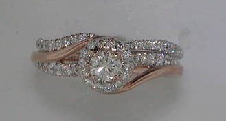 .27ct halo bridal set. 14kt two tone rose and white gold.  45 diamonds =.38ct  style ER10068K44JJ-FWR  $2950.00