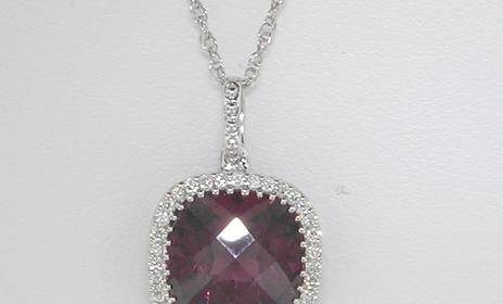 3.26ct rhodalite garnet pendant in 18kt white gold.  34 diamonds = .10ct Style 223-0148 $1600.00