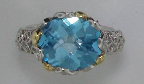 6ct blue topaz ring in sterling silver and 18kt yellow gold. Style 650-0049 $395.00