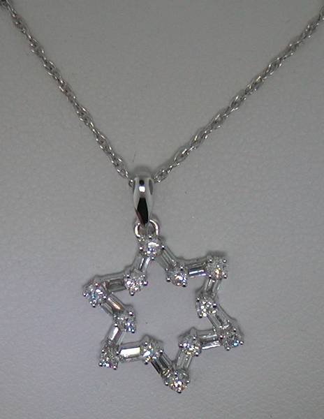18kt white gold 6 sided star pendant with 18in chain.  12 baguette and 12 round diamonds = .61ct  style 905-0001  $1495.00