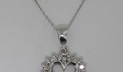14kt white gold heart pendant with 19in chain and 10 diamonds = .15ct  style 750-0319  $395.00