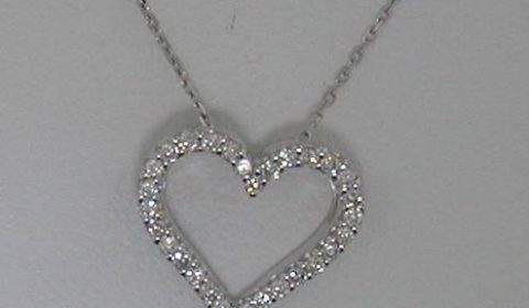 18kt white gold heart pendant with 16in cable link chain with 30 diamonds = .20ct  style 135-0053  $695.00