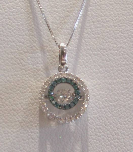 14kt white gold rhythm of love pendant with 18in chain, 17 blue diamonds = .07ct and 28 white diamonds = .32ct  style ROLT013BL  $1700.00