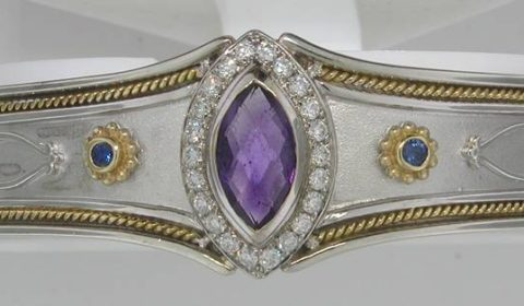 18kt yellow gold and sterling silver cuff bracelet with 1.82ct amethyst, 6 sapphires =.36ct and 22 diamonds =.55ct  style 321-0060  $3500.00