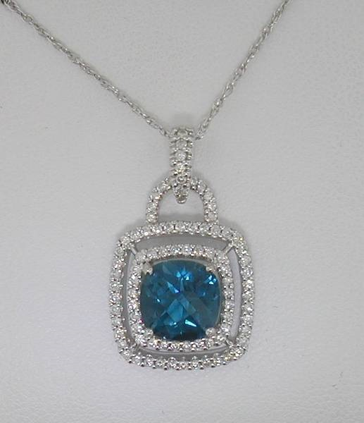 18kt white gold pendant with 18in chain, 2.45ct blue topaz and 85 diamonds =.45ct  Style 500-1412 $2200.00