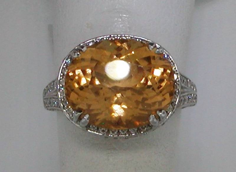 14kt white gold ring with 8.20ct hessonite garnet with 142 diamonds =.68ct Style 627-0002 $5200.00