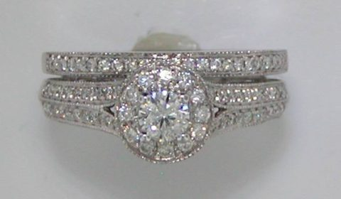 halo bridal set 14kt white gold with .25ct center diamond and 138 side diamonds=.75ct   style 845-0004   $3250.00
