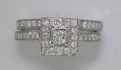 halo bridal set 14kt white gold with .20ct princess cut center diamond and 48 round diamonds =.62ct  style 845-0003   $2900.00