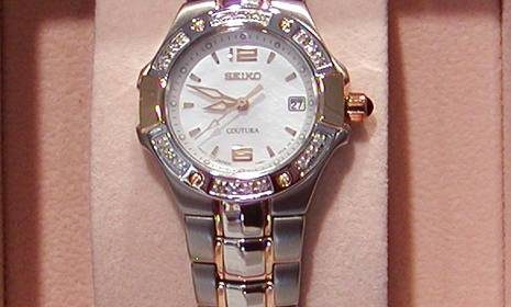 Seiko womans two-tone diamond bezel watch, also in all yellow. style 850-0327 $425.00