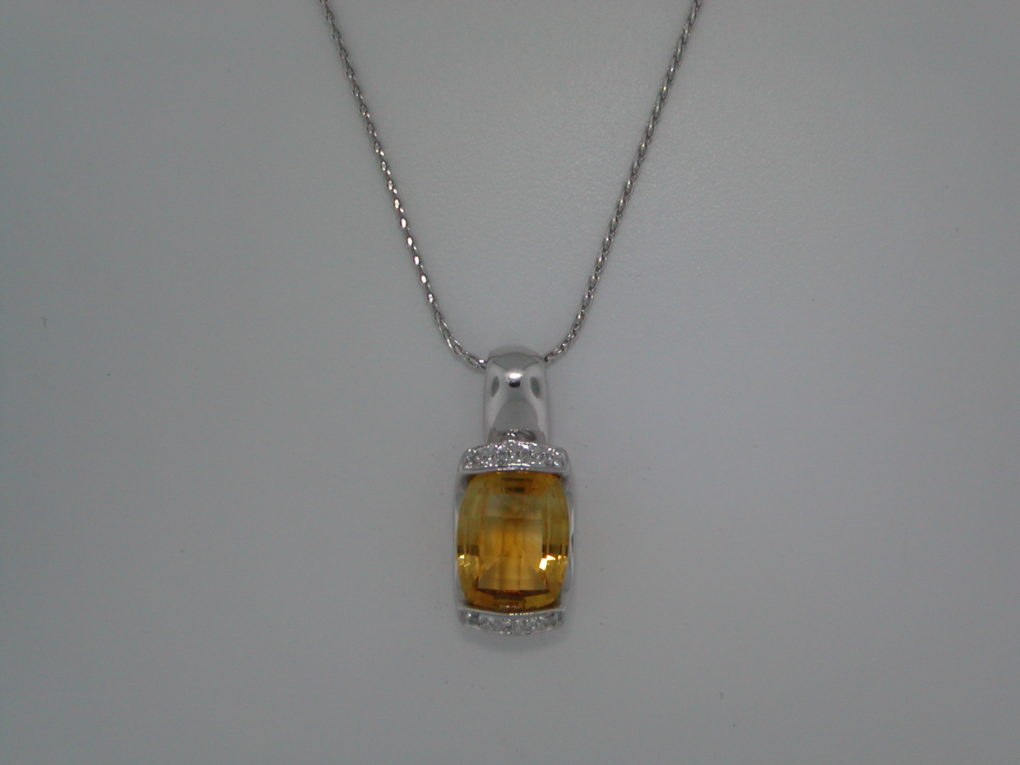 Citrine pendant set in 14kt white gold with 8 diamonds =.04ct and  13X10mm citrine.  18in 14kt chain.  style 101-0001  $1200.00