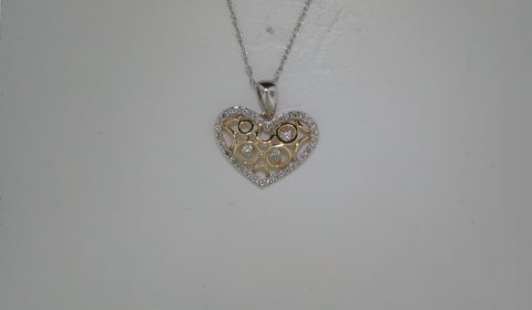 Heart shaped pendant set in 14kt two tone gold  with 49 diamonds =.25ct with an 18in chain  style 345-0002 $1295.00