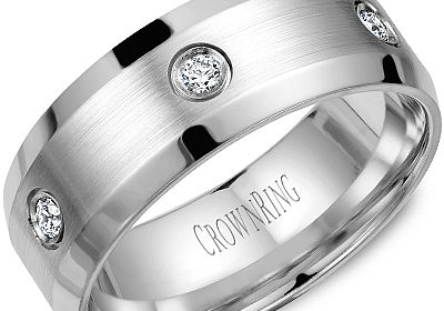 8mm designed wedding band in 14kt white gold with 6 diamonds =.24ct  style 175-0012 $2100.00