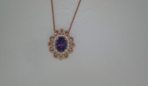 Amethyst pendant set in 14kt rose gold with 26 diamonds =.13ct with an 18in chain style 842-0013 $1225.00