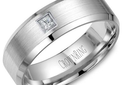7mm designed wedding band in 14kt white gold with 1 princess cut diamond =.10ct style 175-0014  $1750.00