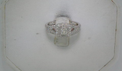 .25ct princess cut set in 14kt rose and white gold halo bridal set with side diamonds =.75ct total weight  style 845-0024 $2500.00