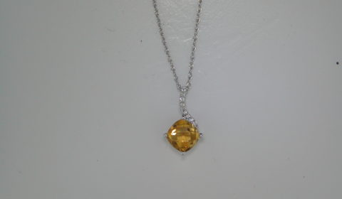 1.36ct checkerboard cut citrine pendant set in 14kt white gold with 9 diamonds =.04ct with an 18in chain  style 950-0032  $525.00