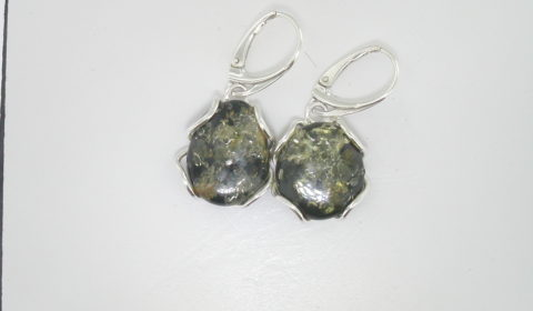 Green baltic amber dangle earrings set in sterling silver  style 930-0033  $75.00