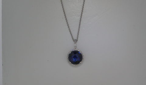 4.01ct blue corundum synthetic pendant set in 14kt white gold with 38 diamonds =.09ct with 16in chain  style 270-0033  $795.00