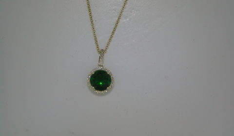 Green cubic zirconia pendant set in 14kt yellow gold with 32 diamonds =.08ct with a 16in chain  style 270-0040  $650.00