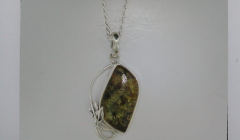 Green amber pendant set in sterling silver with 1.7mm 20in diamond cut rope chain  style 930-0058  $120.00