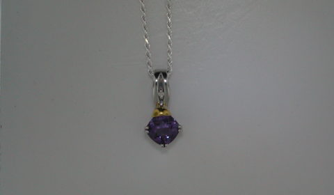 2.40ct amethyst pendant set in 18kt yellow gold and sterling silver with 1 diamond =.02ct with a 1.5mm 18in chain  style 650-0061  $260.00