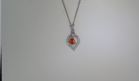 .29ct orange sapphire pendant set in 18kt white gold with 19 diamonds =.15ct with 18in chain  style 135-0063 $950.00