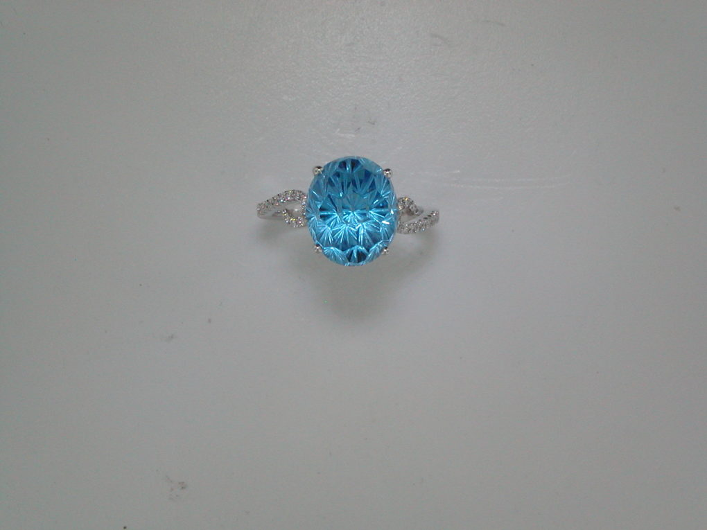 7.17ct daisy oval cut blue topaz ring set in 14kt white gold with 26 diamonds =.13ct  style 950-0064  $1450.00