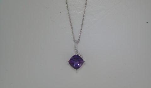 1.26ct checkerboard cut amethyst pendant set in 14kt white gold with 9 diamonds =.04ct with an 18in chain style 950-0077  $550.00