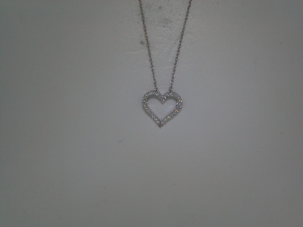 Heart pendant set in 18kt white gold with 30 diamonds =.20ct with 18in 14kt chain.  style 135-0078  $695.00