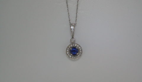 .50ct sapphire pendant set in 14kt white gold with 22 diamonds =.16ct with 18in chain.  style 135-0090  $1295.00