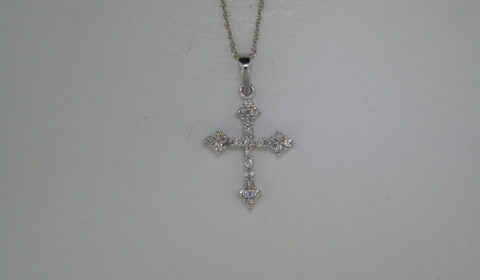 Cross pendant set in 14kt white gold with 23 diamonds =.30ct with an 18in chain.  style 135-0094  $825.00