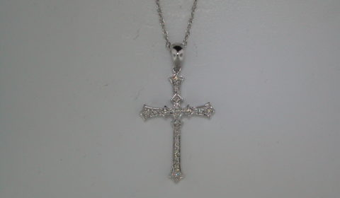 Cross pendant set in 14kt white gold with 26 diamonds =.15ct with 18in chain.  style 135-0098  $850.00
