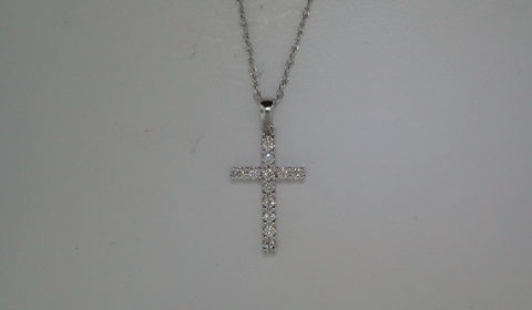Cross pendant set in 18kt white gold with 12 diamonds =.25ct with 18in chain style 135-0099 $775.00