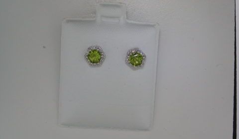 1.33ct peridot earrings set in 14kt white gold with 12 diamonds =.05ct  style 223-0103  $525.00