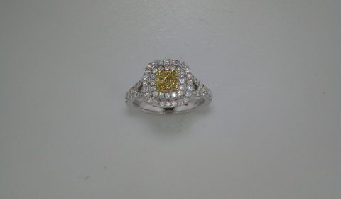 .21ct yellow diamond ladies ring in 18kt white gold with 62 white diamonds =.67ct  style 135-0103  $2950.00