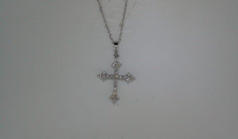 Cross pendant set in 14kt white gold with 24 diamonds =.30ct with an 18in chain  style 135-0106 $895.00