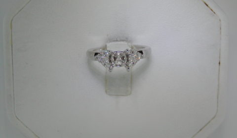 Semi-mount engagement ring set in 14kt white gold with 12 diamonds =.30ct style 405-0111 $1350.00