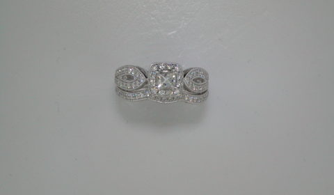 .25ct princess cut halo bridal set in 14kt white gold with 75 diamonds =.60ct with matching wedding band.  style ER911592S1W44JJ $3750.00
