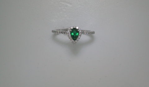 .45ct emerald pear shape ladies ring in 14kt white gold with 32 diamonds =.25ct  style 135-0122  $1450.00