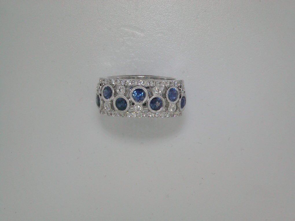 1.47ct sapphire ladies ring in 18kt white gold with 45 diamonds =.50ct and 7 sapphires.  style 135-0124  $3450.00
