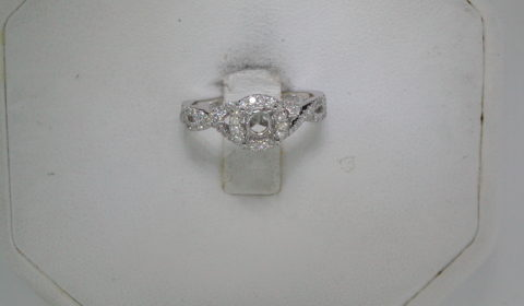 semi-mount engagement ring set in 14kt white gold with 69 diamonds =.29ct  style ER9512W44JJ $1950.00